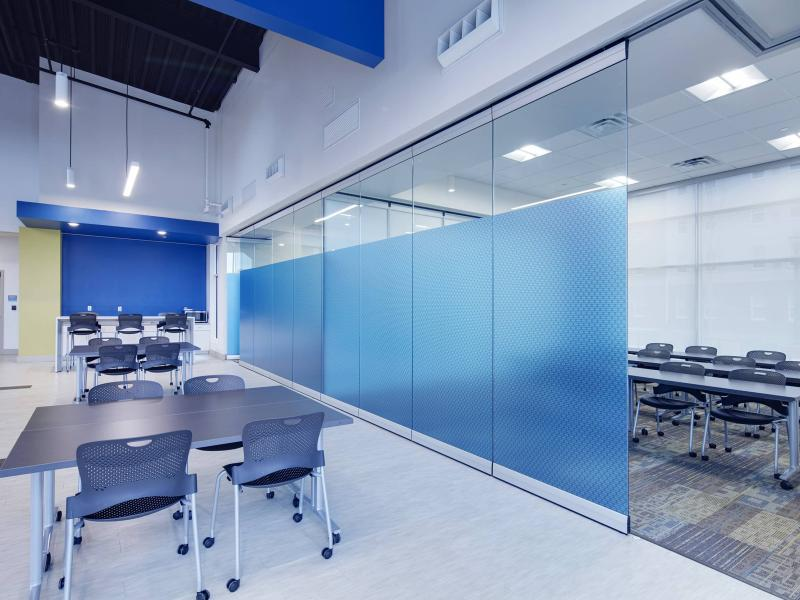 Classroom with blue walls and divider